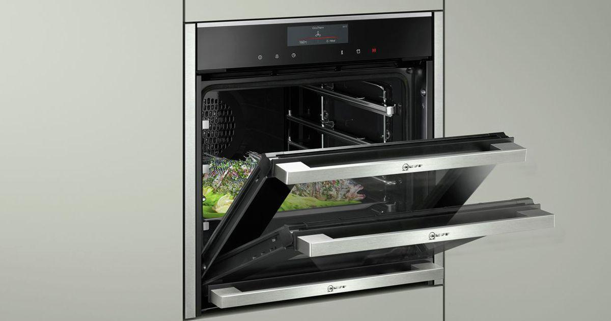 ovens with slide and hide doors. Black Bedroom Furniture Sets. Home Design Ideas